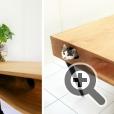 Столешница CATable, которая служит крышей домику для кошки, изготовлена из цельного куска дерева и имеет лазы